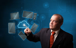 Businessman standing and touching high technology Stock Photo