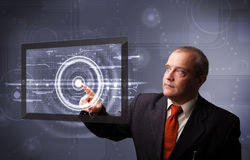 Businessman standing and touching Stock Image