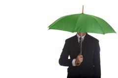 Businessman standing umbrella. stock photos