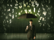 Businessman standing with umbrella and 3d numbers raining concep Royalty Free Stock Photo