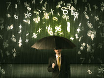 Businessman standing with umbrella and 3d numbers raining concep Stock Photography