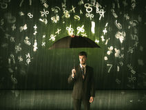 Businessman standing with umbrella and 3d numbers raining concep Stock Photo