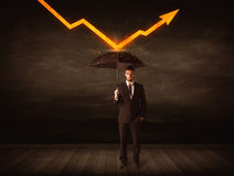 Businessman standing with umbrella keeping orange arrow Royalty Free Stock Image