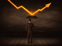Businessman standing with umbrella keeping orange arrow Royalty Free Stock Images