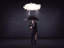 Businessman standing with umbrella and little storm cloud Stock Images
