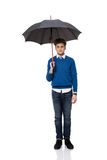 Businessman standing under umbrella Stock Images