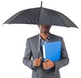 Businessman standing under umbrella Stock Image