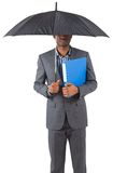 Businessman standing under umbrella Royalty Free Stock Image