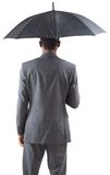 Businessman standing under umbrella Royalty Free Stock Photo