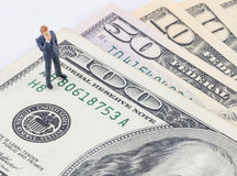 Businessman standing on the US dollar banknote Royalty Free Stock Images