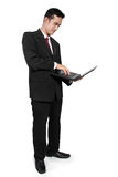 Businessman standing use laptop Stock Image