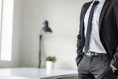 Businessman standing waiting in his office Stock Images