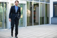 Businessman standing waiting for someone Stock Photos