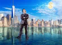 The businessman standing on the water Royalty Free Stock Photography