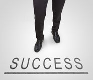 Businessman standing wearing court shoes on success line. Royalty Free Stock Image