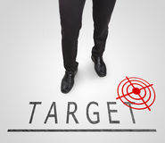 Businessman standing wearing court shoes on target(aim) line. Businessman standing wearing court shoes on target(aim) line Royalty Free Stock Photo