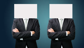 Businessman standing white paper face holding front of head Stock Image