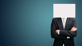 Businessman standing white paper face holding front of head Royalty Free Stock Image