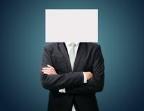 Businessman standing white paper face holding front of head Royalty Free Stock Images