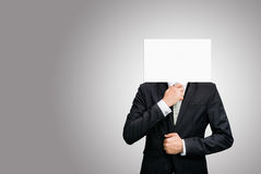Businessman standing white paper face holding front of head Royalty Free Stock Photo