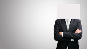 Businessman standing white paper face holding front of head Stock Photography
