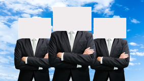 Businessman standing white paper face holding front of head Royalty Free Stock Photography