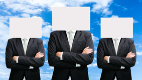 Businessman standing white paper face holding front of head Stock Photo