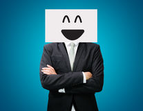 Businessman standing white paper happy smile face holding front Royalty Free Stock Photography