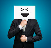 Businessman standing white paper happy smile face holding front Royalty Free Stock Images