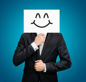 Businessman standing white paper happy smile face holding front Stock Photography
