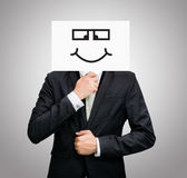 Businessman standing white paper happy smile face holding front Stock Image