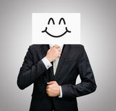 Businessman standing white paper happy smile face holding front Royalty Free Stock Photos