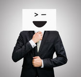 Businessman standing white paper happy smile face holding front Stock Photo