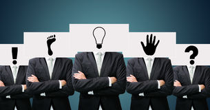Businessman standing white paper ideas face holding front of hea Stock Image