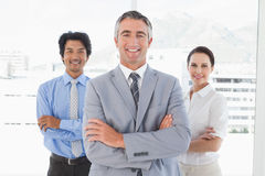 Businessman standing with work colleagues Stock Photography