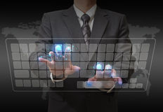 Businessman standing and working with touch screen Royalty Free Stock Images