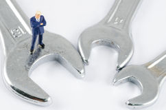 Businessman standing on the wrench, Problem solving co Stock Image