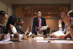 Businessman stands addressing team at meeting, low angle stock image
