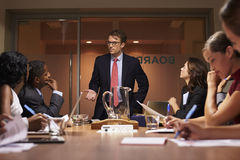 Businessman stands addressing team at meeting, low angle Stock Photography