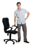 The businessman stands an armchair Royalty Free Stock Photography