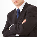 Businessman stands with folded hands. Close-up on a white background Royalty Free Stock Photography