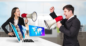 Businessman stands near laptop with many screens. Stock Photography