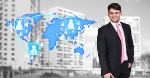 Businessman stands near map with icons Stock Photo