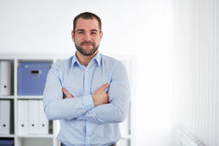 Businessman stands in the office Stock Photography