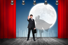 Businessman stands on the scene with curtains Stock Images