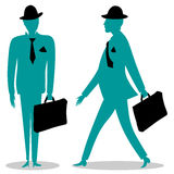 Businessman stands and walks Stock Photo