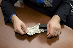 Businessman stapling. A businessman stapling some money Stock Photos