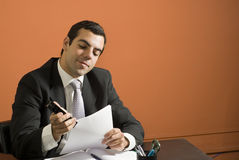 Businessman Stapling Papers - Horizontal Stock Photography