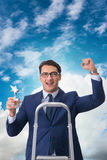 The businessman with star award against sky Stock Images