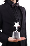 Businessman with star award isolated Royalty Free Stock Image